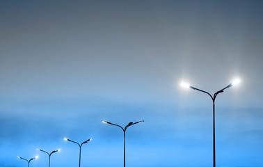 Urban landscape with modern minimal street lights and vibrant sky Fotomurales