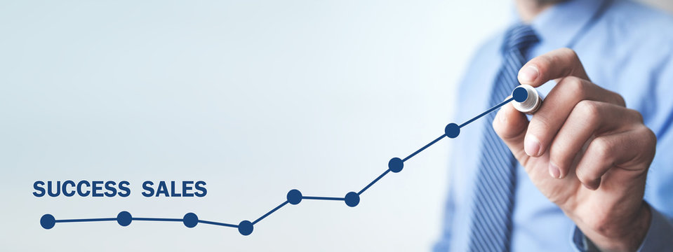 Man with growth graph. Success sales