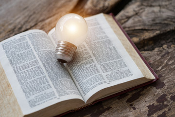 The holy bible with light bulb.