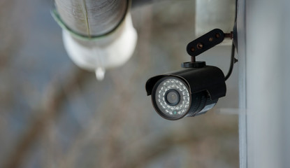 surveillance video camera mounted on house. home security concept