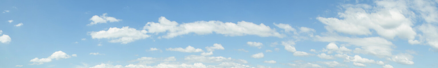 Panorama image of Beautiful white clouds with blue sky in summer seasonal.