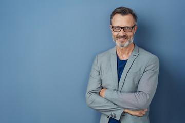 Friendly confident professional man on blue Fotobehang