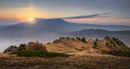 Sunset or sunrise in the mountains. Scenic view. Blue sky