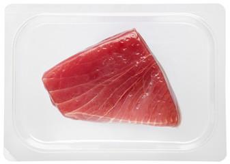 Fresh tuna steak vacuum packed in plastic