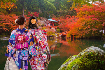 Women in traditional japanese kimonos watching amazing tempe in Kyoto at autumn. Japan Wall mural