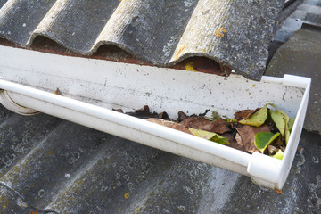 Cleaning rain gutters from leaves. Roof Gutter Cleaning Tips. Gutter Cleaning.