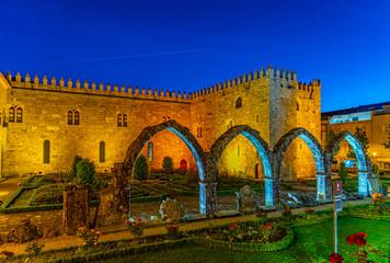 Sunset view of Archbishop palace viewed through gardens of Santa Barbara in Braga, Portugal
