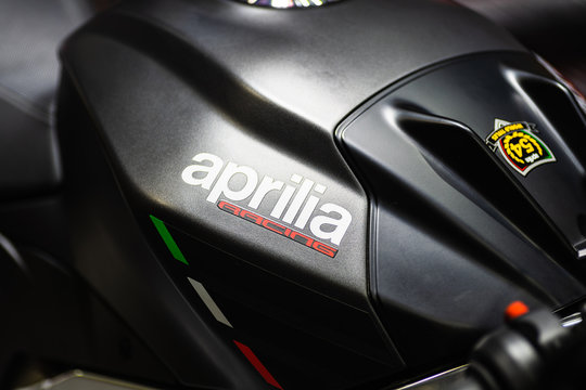 Bangkok, Thailand - Decemeber 5, 2019 : Aprilia racing  logo on the body of black sports motorbike at a car show. Aprilia is an Italian motorcycle company, owned by Piaggio.