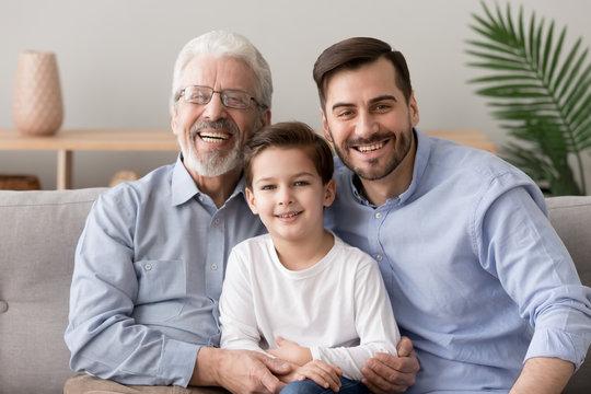Grandfather son and grandson multi generational family portrait