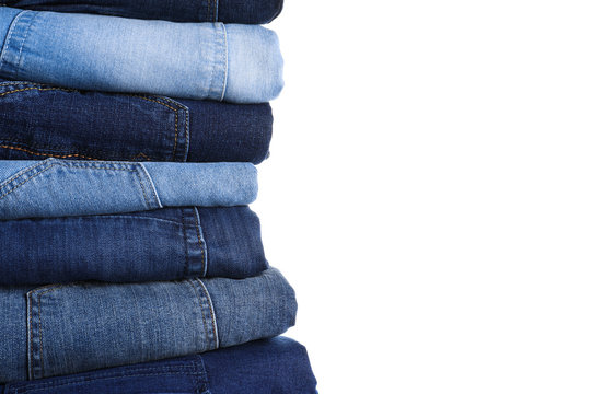 Stack of different jeans isolated on white