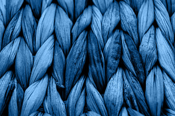 Spoed Fotobehang Macrofotografie Rustic natural wicker texture toned in classic blue monochrome color. Braided pattern macro photography.