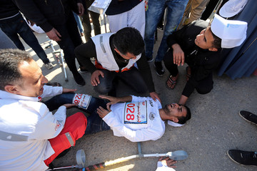 Paramedics tend to a Palestinian amputee during a local run racing in the central Gaza Strip
