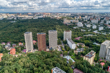 Big city, aerial view. The microdistrict of a big city, residential buildings with many high-rise buildings.