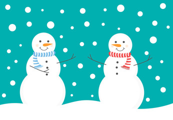 Two snowman enjoy snow fall in winter scenery.