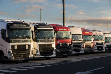 Row of trucks on a truck overnight parking along the E17 highway in Belgium on June 23, 2017.