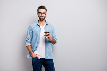 Photo of business macho guy young boss holding hot takeout coffee beverage walking office morning good mood wear specs casual denim outfit isolated grey color background