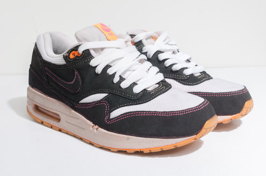 london, england 05/08/2018 Nike Air max 1 customs , White and black with pink stitching and orange sole. Nike air max retro classic sneaker trainers. Nike sport and street wear fashionable athletic