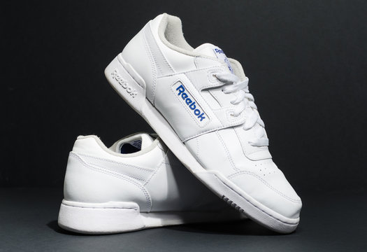 london, england, 05/05/2018 Reebok classic Workout plus Hipster unisex Stone Trainer Size UK 9 on a black stdio background. retro vintage british made shoes.