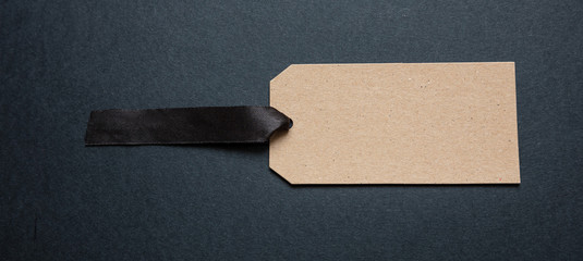 Wall Mural - Beige recycled price card against black background