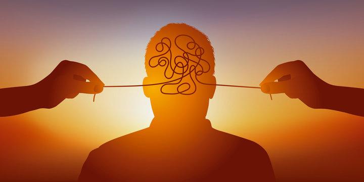 Concept de la folie et des maladies mentales avec un homme vu de face et des mains qui tire un fil pour symboliquement dénouer les nœuds de son cerveau.