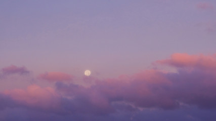 Purple sunset sky with full moon. Nature background