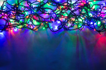 Christmas background with lights and free text space. Christmas lights. Glowing colorful Christmas lights . New Year. Garland.