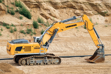 Liebherr R-966 crawler excavator in the Garzweiler open-pit mine used for earthmoving and quarrying work in the Garzweiler open-pit mine, Germany, July 2, 2017