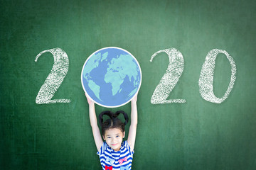 2020 new educational academic calendar year for school class with student kid raising world global planet on teacher's green chalkboard for back to school celebration, classroom schedule