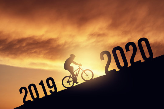 2020 new year concept with the silhoutte of a bicycle rider, metmorphing the changes of years