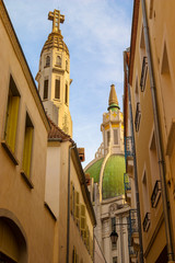 A low angle shot of a dome and a bell tower of the Art Deco style Church Saint-Blaise. Vichy, France.
