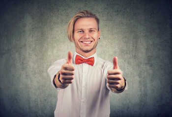 handsome man giving thumbs up gesture