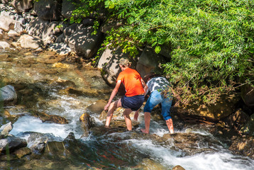 kids playing by a water creek