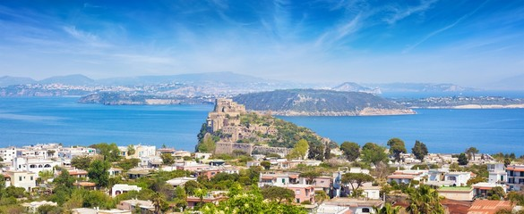 Panoramic aerial view of Gulf of Naples, Ischia Island and famous landmark and tourist destination Aragonese Castle or Castello Aragonese, Italy.