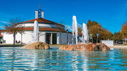 Beautiful view with reflections and a nice chapel at Therme Bad Griesbach, Bavaria, Germany