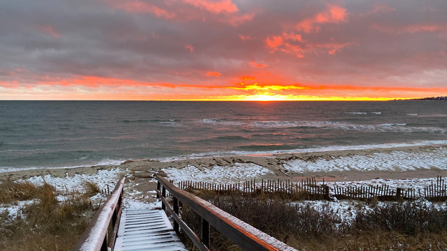 A Sunset Bursts Through After a Snow Squall on the Beach