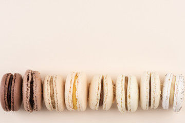 French Macaroons Cookies in Pastel Colors. Flat Lay with Copy Space