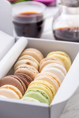 Colorful French Macaroons in Box with Coffee