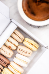 Macaroons and Coffee on Table. Top Down Flat Lay View