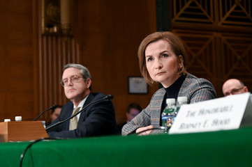 McWilliams and Quarles testify before a Senate Banking, Housing and Urban Affairs Committee hearing in Washington