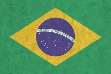 Poster Brésil Brazil flag depicted in bright paint colors on old relief plastering wall. Textured banner on rough background