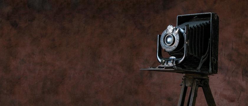 old camera on vintage background