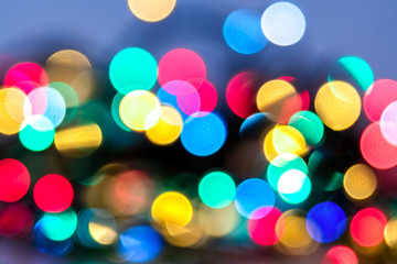 Abstract Christmas and carnival background with colorful bokeh lights of garland, red, green, blue,...