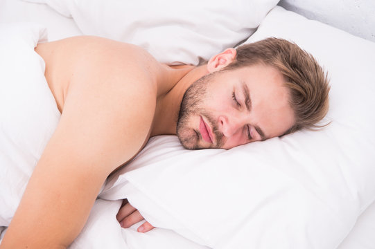 Man handsome unshaven guy in bed. Tips sleep better. Bearded man relaxing on pillow. Soft pillow. Enough amount sleep every night. Health care concept. Circadian rhythm regulates sleep wake cycle