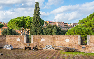 Terrace with cannon and cannon balls in Castel Sant'Angelo in Rome on a sunny afternoon. Italy.