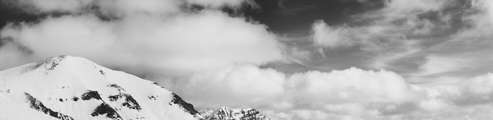 Fototapete - Panorama of snowy mountains and sky with clouds at winter