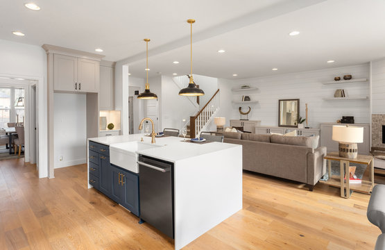 Beautiful kitchen and living room in new home with open concept floorplan
