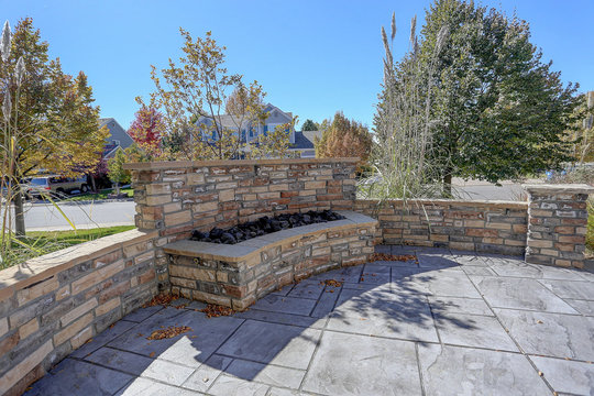 Beautiful residential  seculded front patio on suburban street with firepit