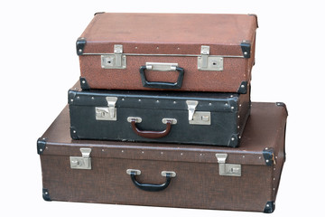 old vintage suitcases stacked isolated on white background