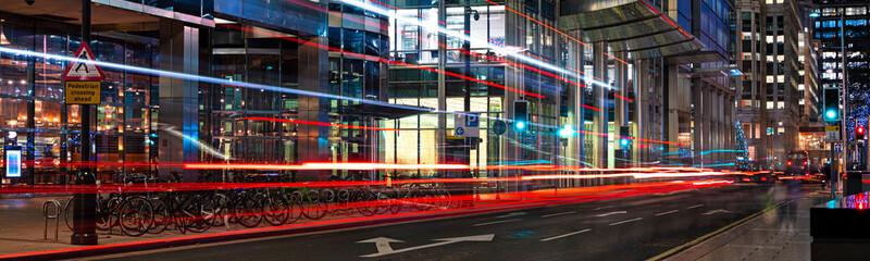 Aluminium Prints Night highway Busy city street at night with light streaks from vehicles panoramic