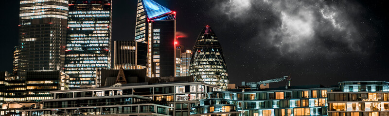 Londons modern city skyline at night panoramic